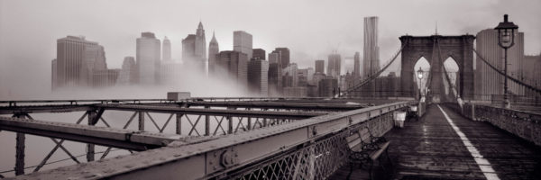 New york city skyline from the brooklyn bridge on a misty day