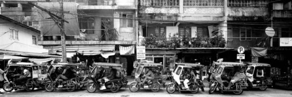 trikes in the philippines lining the street