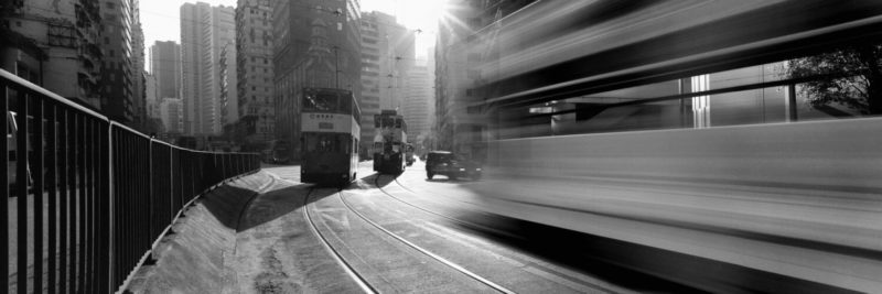 Trams rushing by in hong kong