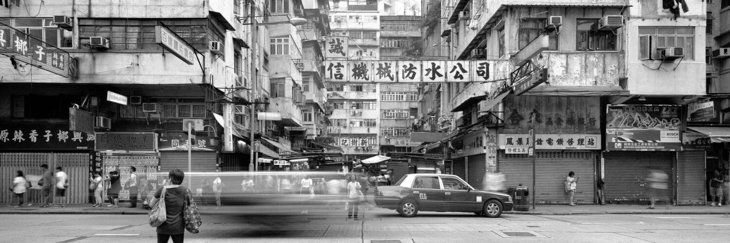 black and white street scene in mong kok hong kong