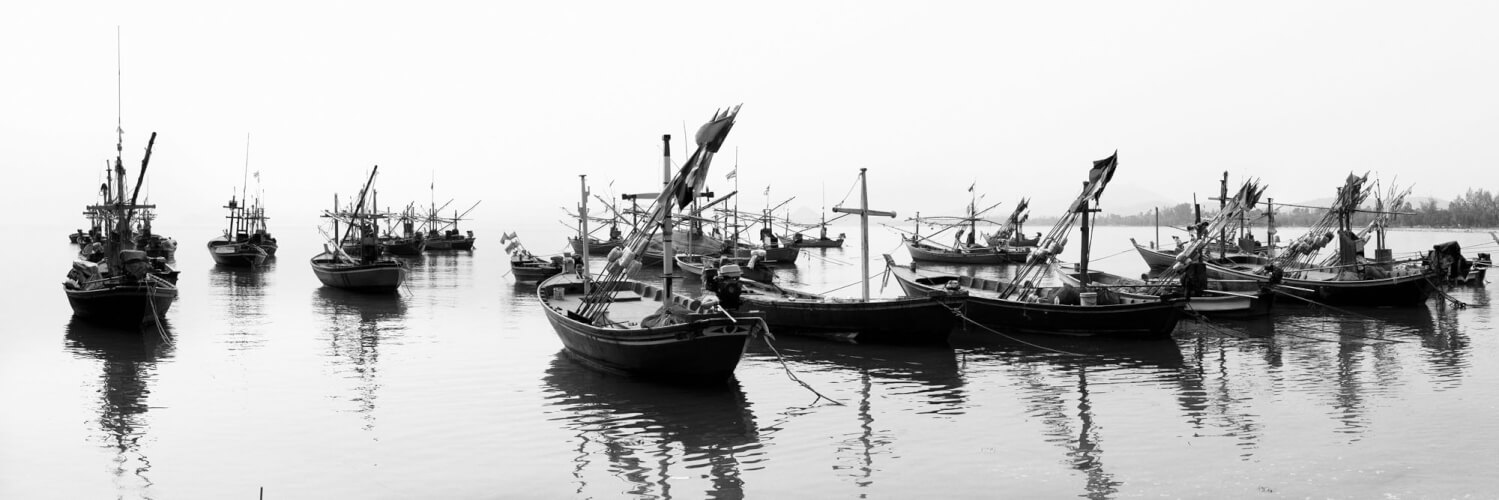 Fishing boats moored in thailand in black and white