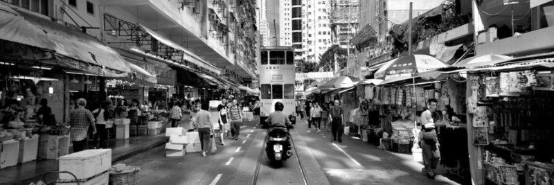 Tram passing through the market in Hong Kong Island