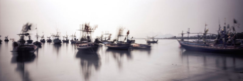 Fishing boats in thailand in motion
