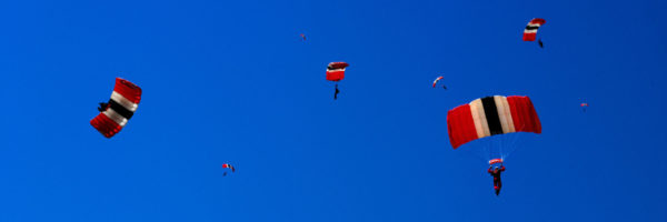 Sky divers with their parachutes open