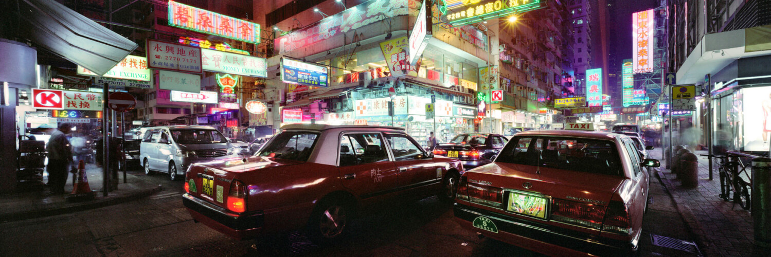 Hong Kong taxis on a neon lit street in mong kok