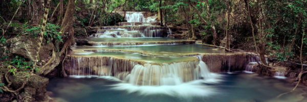 Emerald water flows down the Huai Mae Khamin waterfall