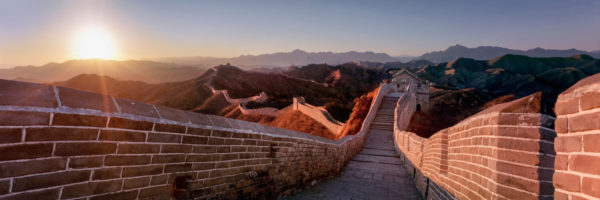Jinshanling great wall of china snaking into the distance at sunset
