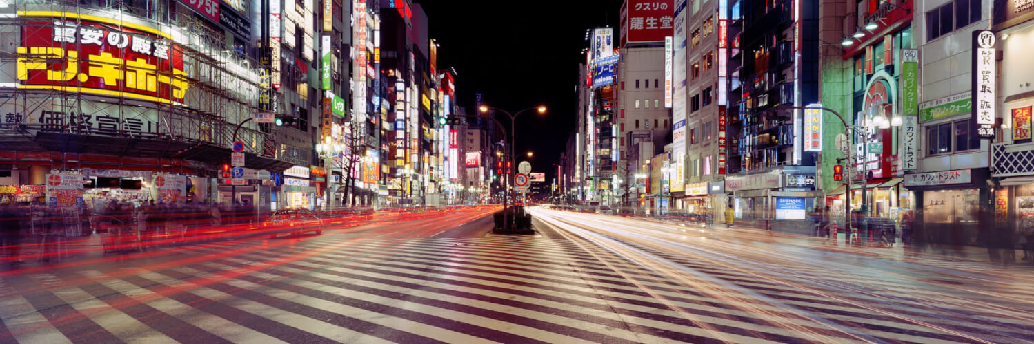 Tokyo Street Crossing at Night with traffic light trails