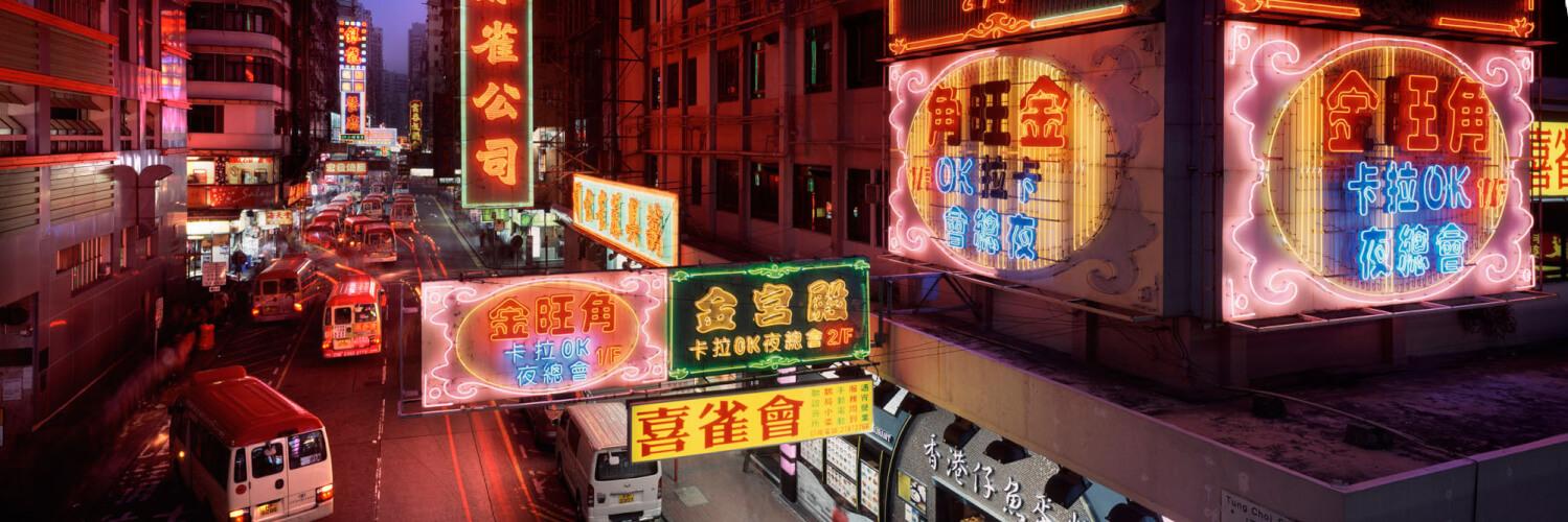 right Neon signs light up a street in Mong Kok Hong Kong