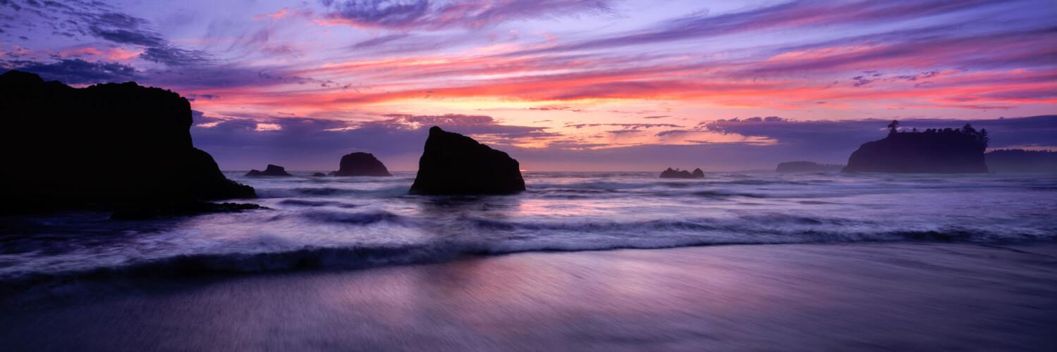 Beautiful sunset on ruby beach between the huge rocks