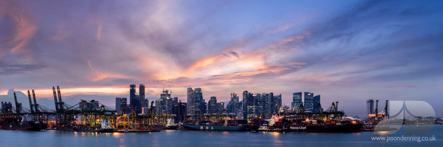 Singapore docks from sentosa at sunset