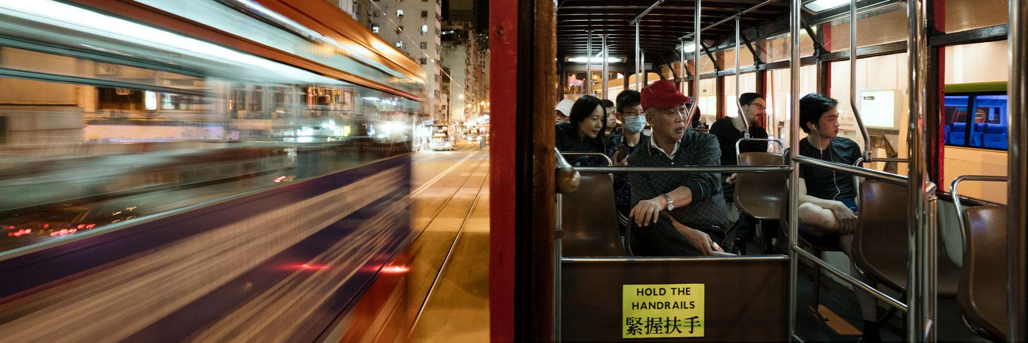 Scene on a Hong Kong tram a night