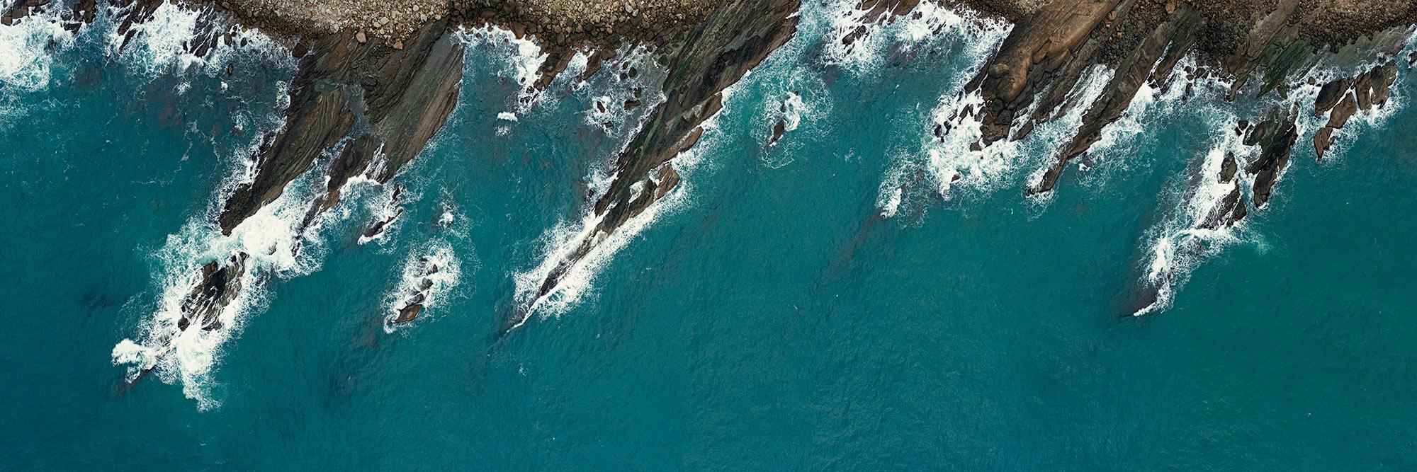 jagged rocky coast drone