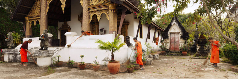 Monks sweeping the temple