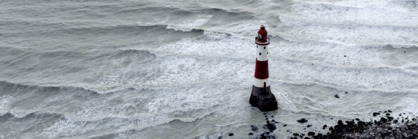 England lighthouse amongst stormy waves