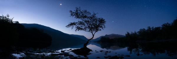 Snowdonia national park lake at night with the moon and stars