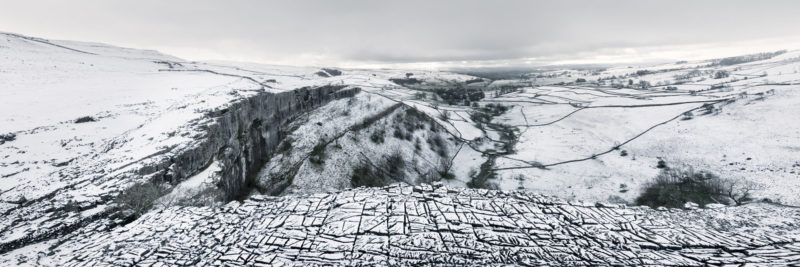 a panoramic print of Malham cover in North Yorkshire Dales covered in snow