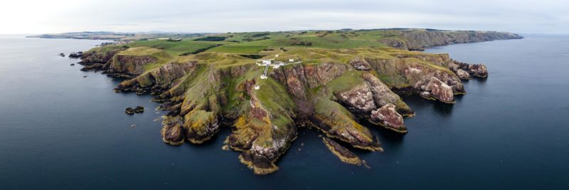 Scottish rugged coast and lighthouse