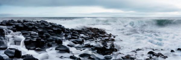 a panoramic print of the giant's causeway on a stormy day
