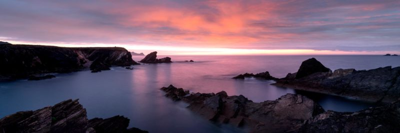 panoramic print of sunset on the single peninsula