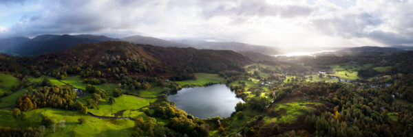 A panoramic print of loughrigg tarn and fell in cumbria
