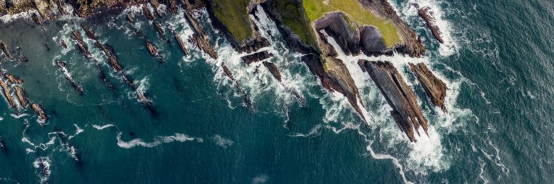 aerial shot or the rugged rocky Irish coast