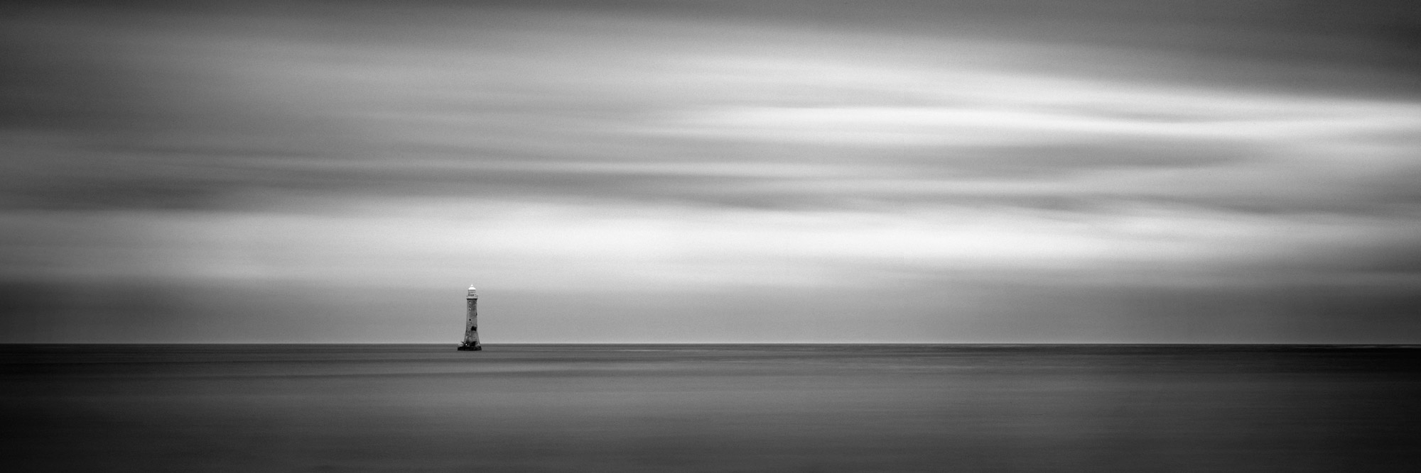 Artistic black and white print of the Haulbowline Lighthouse in Northern Ireland