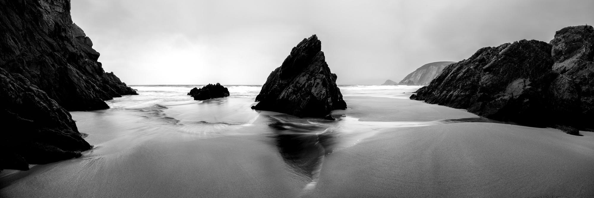 black and white panoramic print of coumeenole beach as the tide comes in
