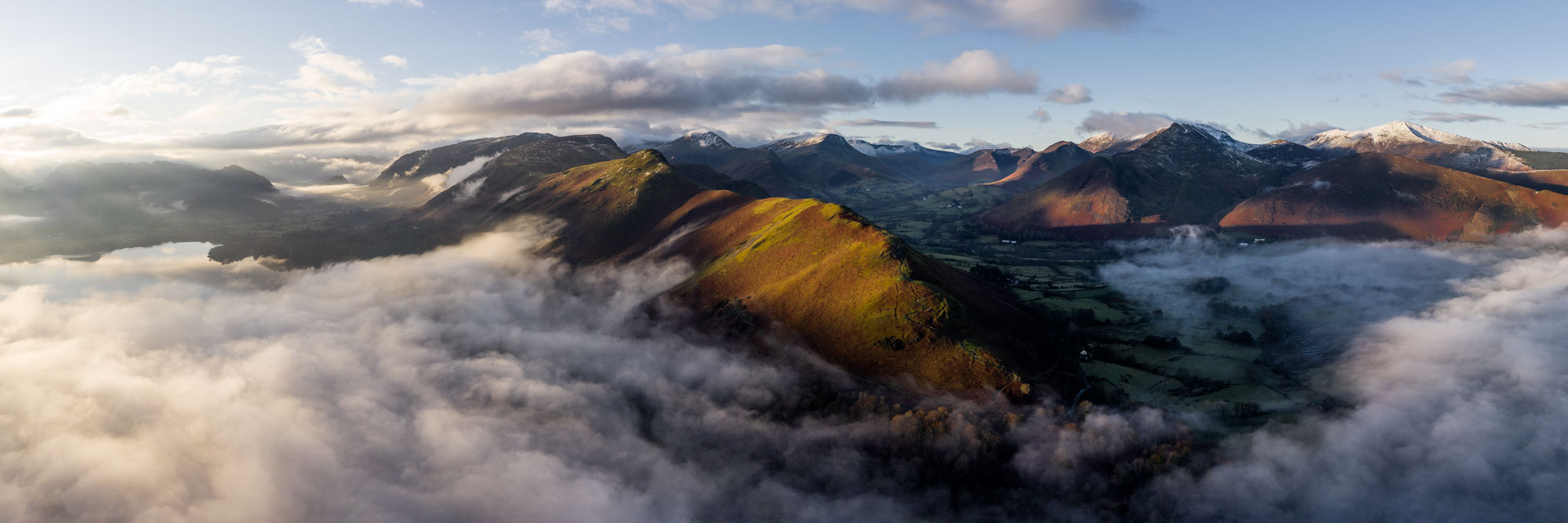 Panorama of Catbells fell surrounded by mist