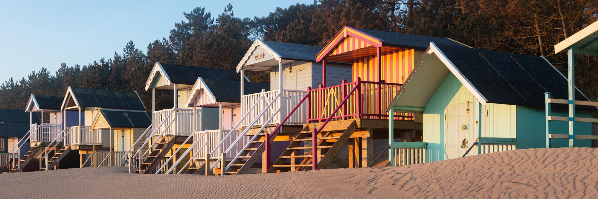 Colourful Beach huts at dawn on an English beach