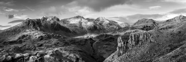 Panorama of the Eskdale needle and scafell pike in the lake district in black and white