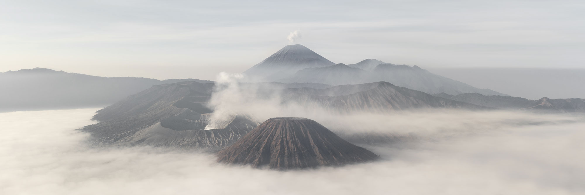 Panorama of Mount Bromo on a misty day cloud inversion
