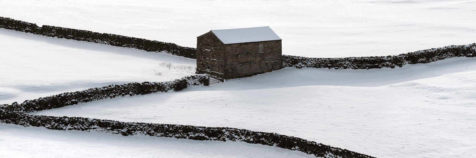 Yorkshire Dales barn covered in snow panoramic