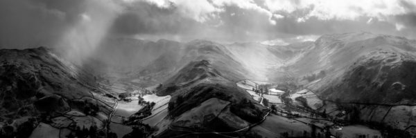 two valleys during a rain storm in martingale lake district b&w