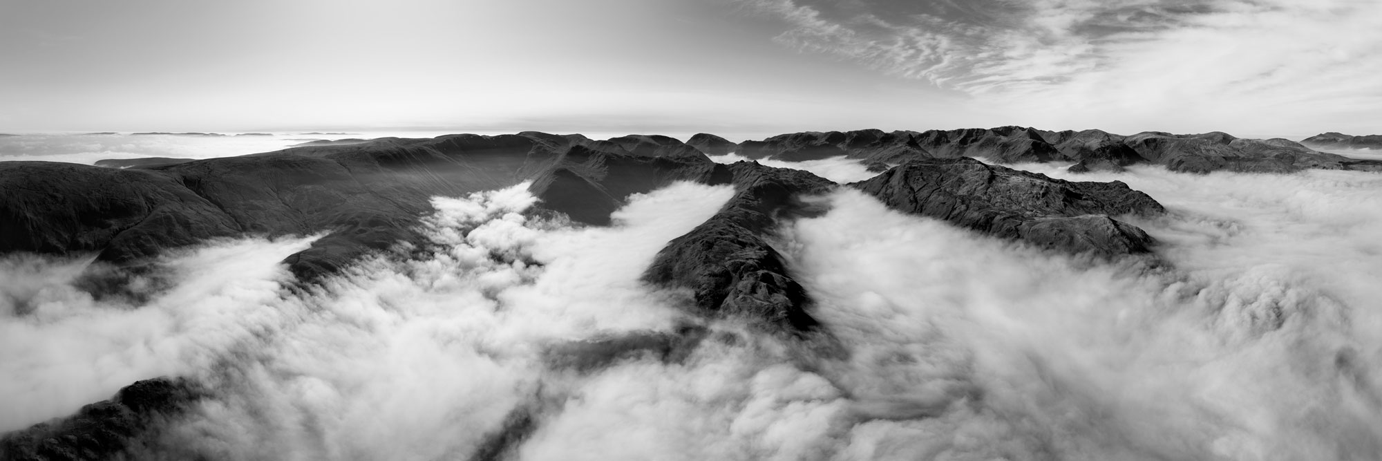 black and white aerial of a cloud inversion in the Lake District
