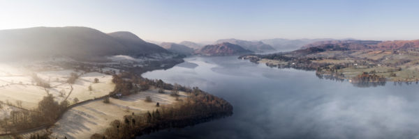 Ullswater lake on a frosty and misty morning in the Lake District