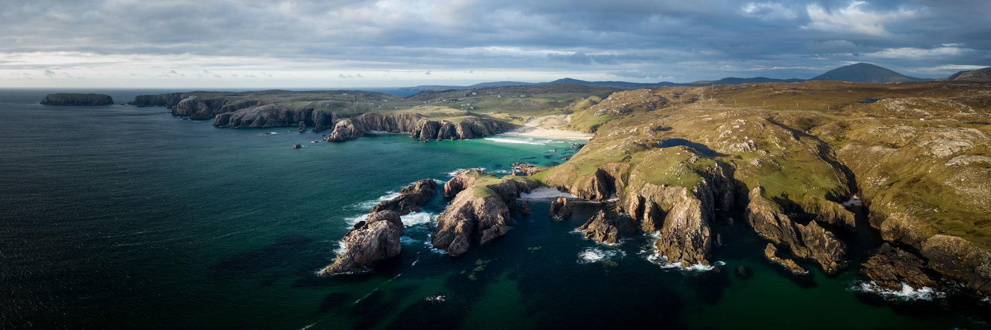 Mangurstadh cliffs and beach aerial in Scotland