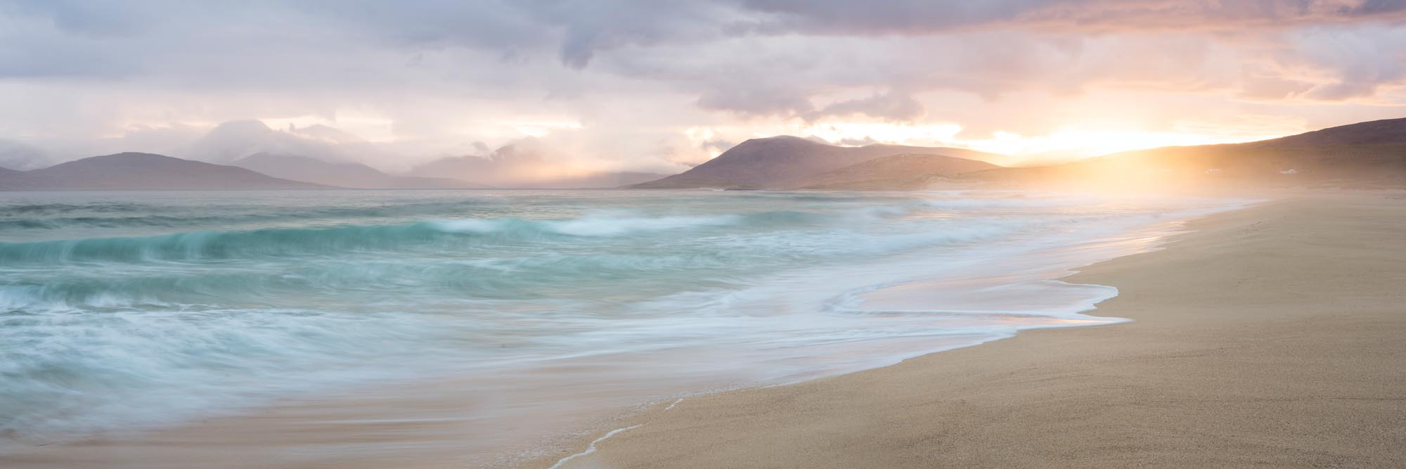 white sand beach at sunrise in the outer Hebrides