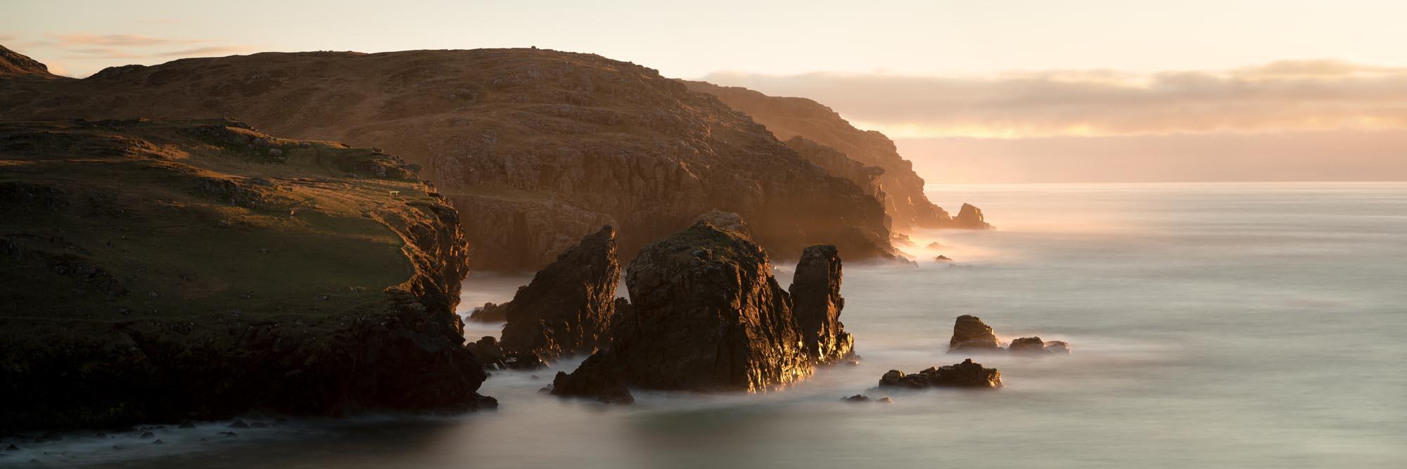 dhail beag beach cliffs at sunset