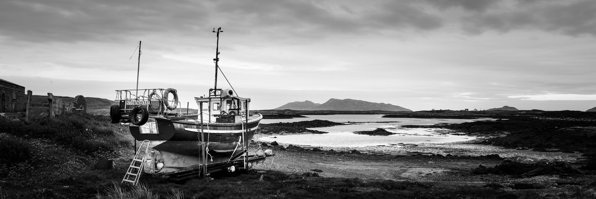 Fishing boat on the shores of a scottish lake b&w