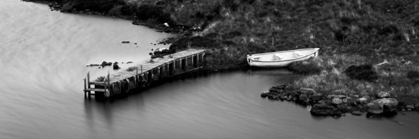 B&W boat and Scottish jetty on a loch