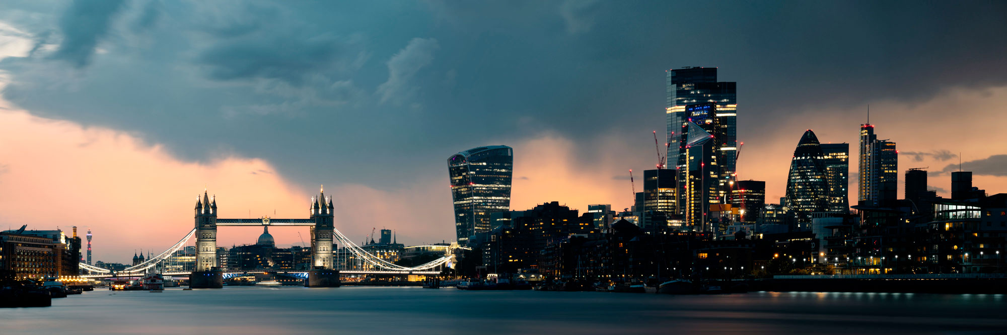 summer storm passing over the London skyline at sunset