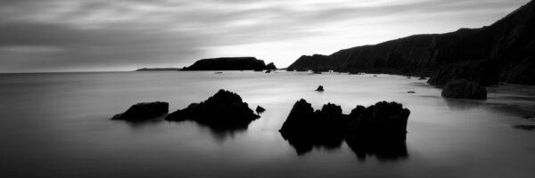 b&w males sands beach Wales