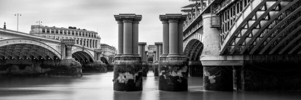b&w panorama of the pillars of the old Blackfriars railway bridge