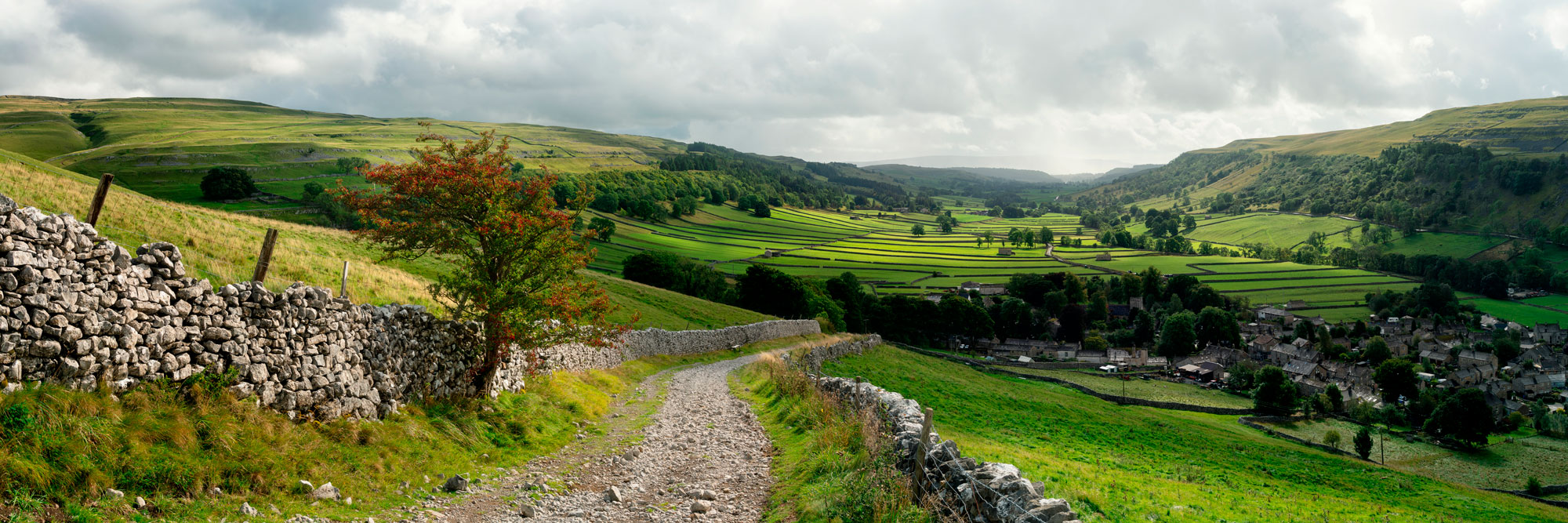 Winding country stone road Yorkshire Dales