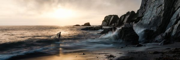 Panorama of the dramatic Ayrmer Cove at sunset along the southwest coast path in Devon