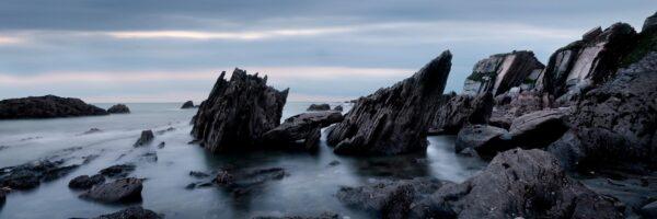 Panorama of the dramatic slate Devon coast