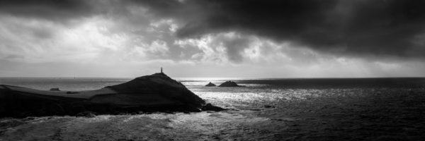 Dramatic black and white panorama of Cape Cornwall along the south west coast path