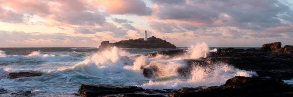 Panorama of the Godrevy Lighthouse at sunset in Cornwall