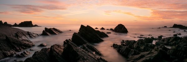Panorama of Hartland Quay at sunset along the south west coast path in Devon